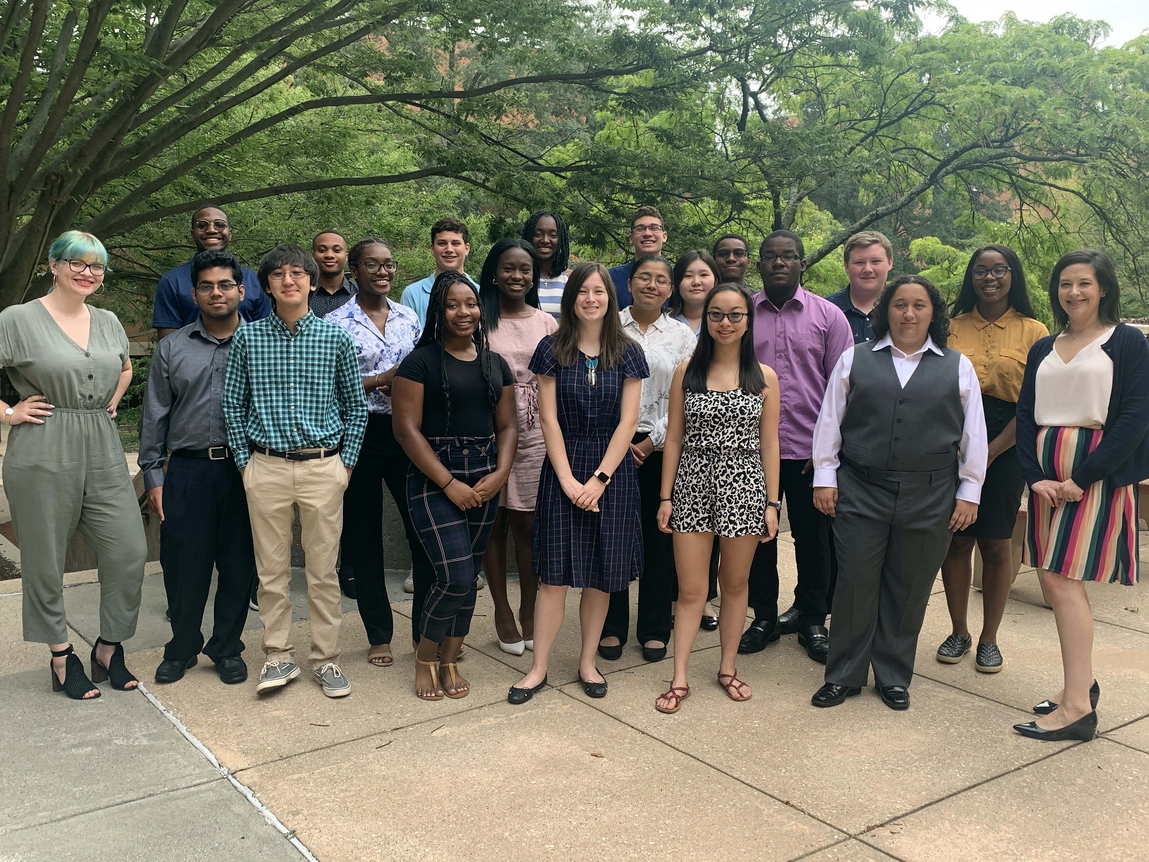 The newest UMBC BUILD Trainees stand with one of their mentors, Laura Ott, Ph.D.