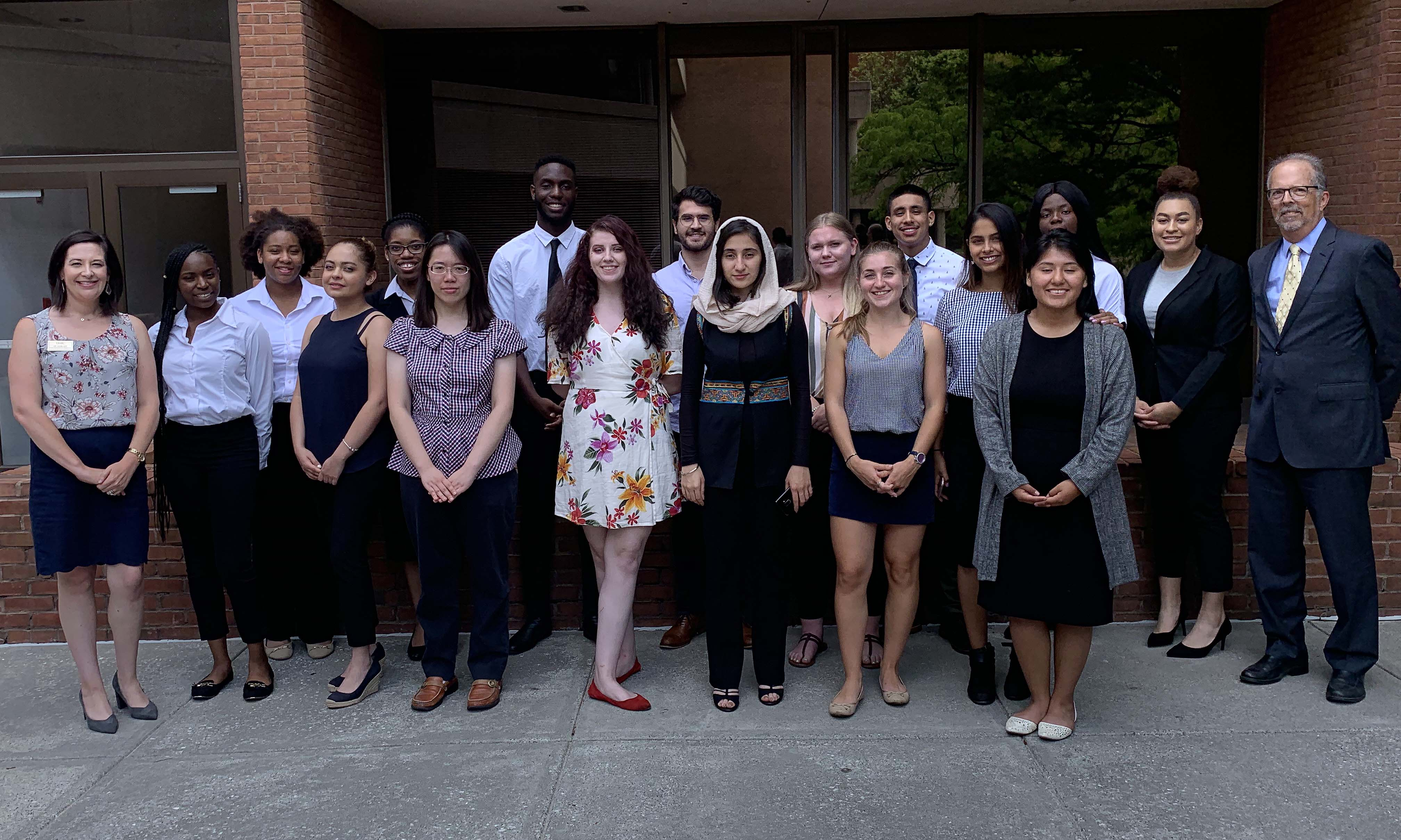 UMBC's 2019 BUILD a Bridge to STEM interns pose with two of their mentors, Laura Ott, Ph.D., and Phil Farabaugh, Ph.D.